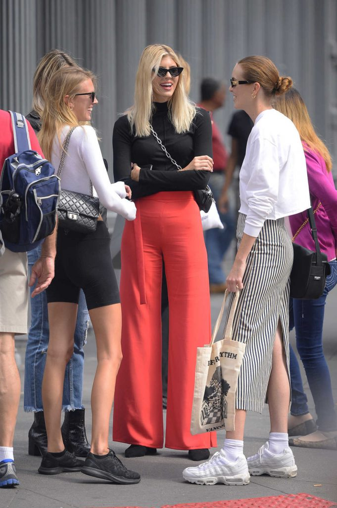 Devon Windsor in a Red Trousers