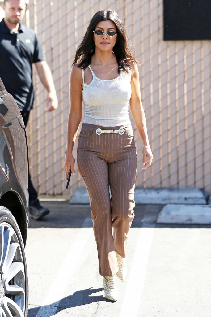 Kourtney Kardashian in a Light Brown Striped Trousers
