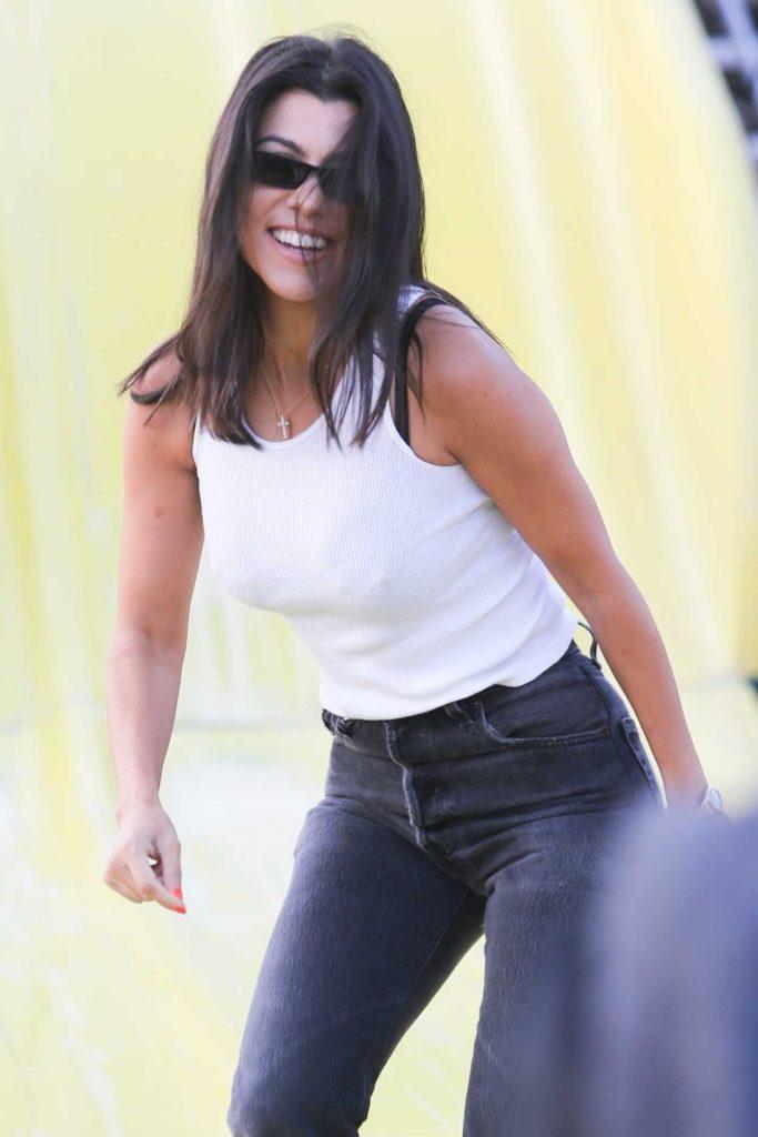 Kourtney Kardashian in a White Tank Top Attends the Malibu