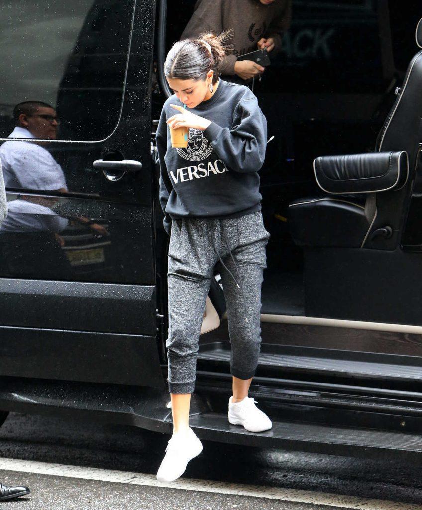Selena Gomez in a Black Versace Sweatshirt