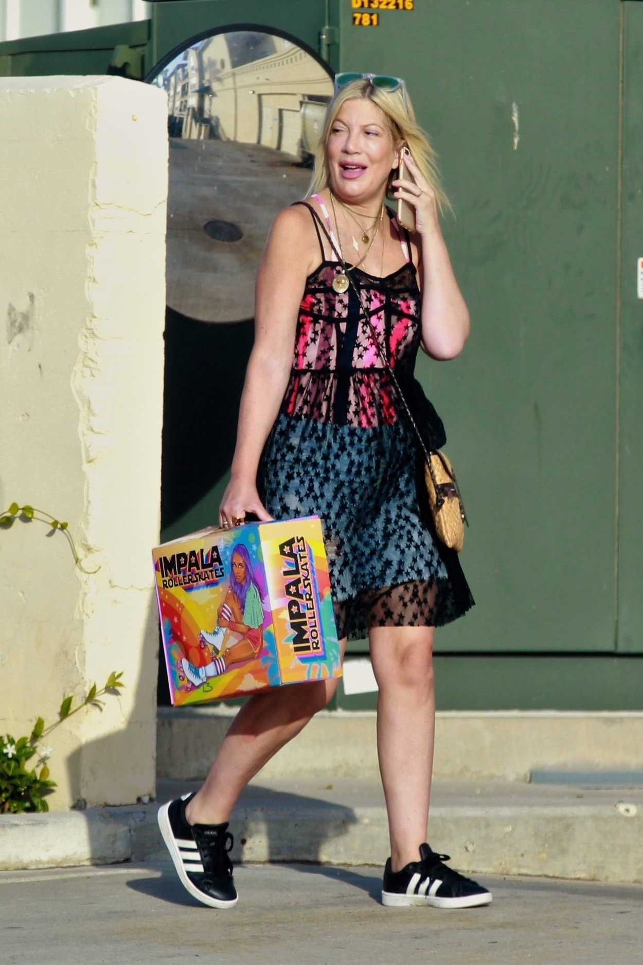 Tori Spelling In A See Through Dress Arries Roller Skates