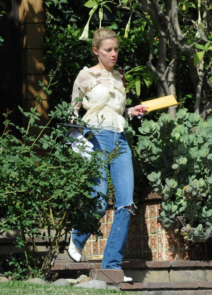 Amber Heard in a Blue Ripped Jeans