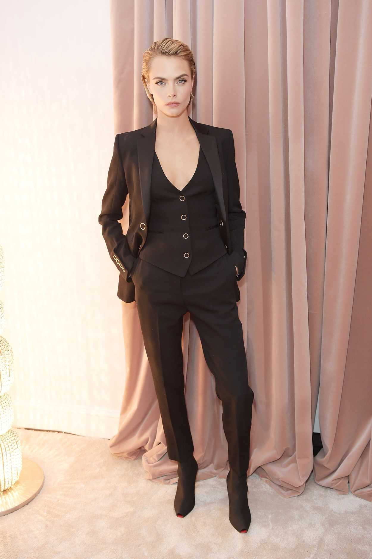 Cara Delevingne Attends the Launch of a New Burberry ...