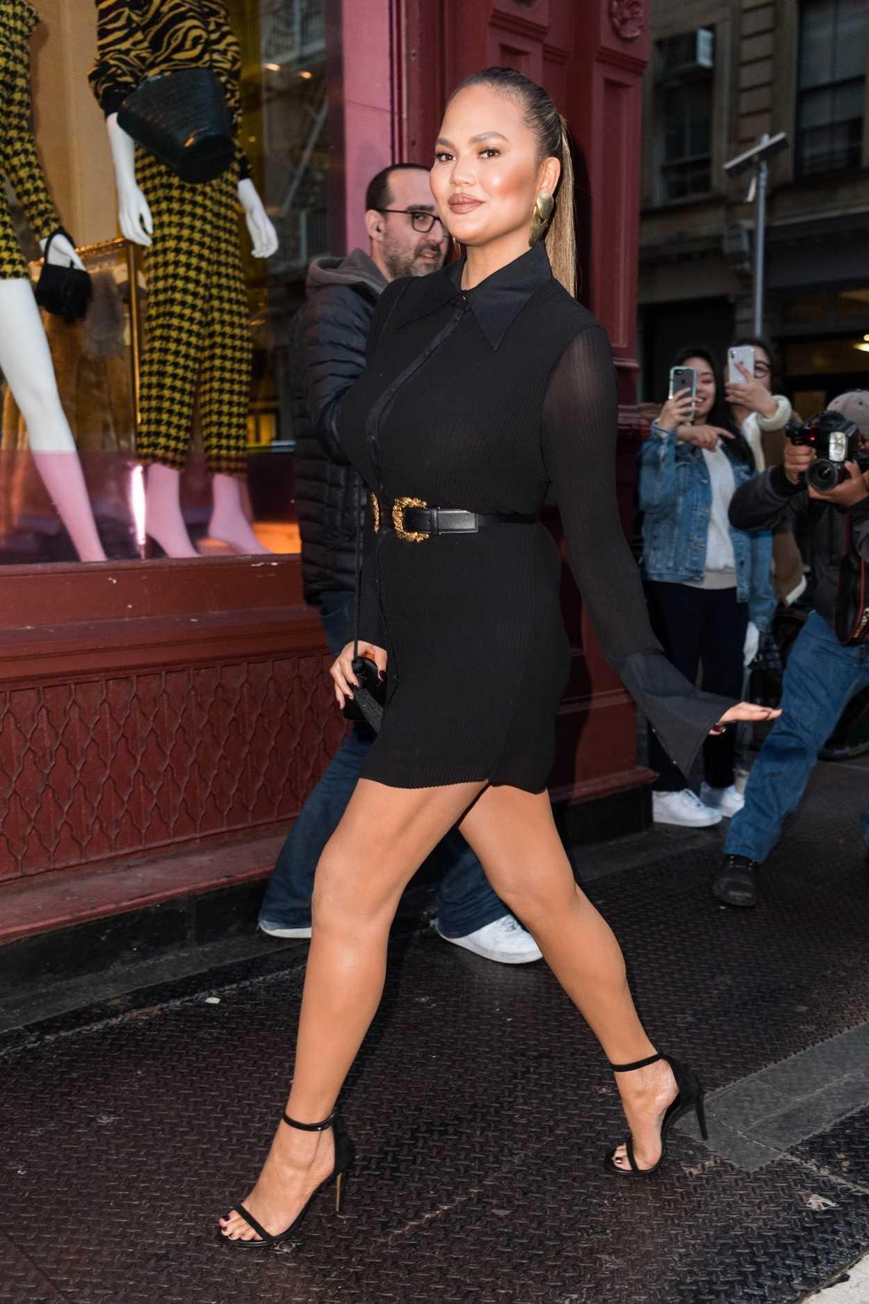 Chrissy Teigen In A Short Black Dress Was Seen Out In