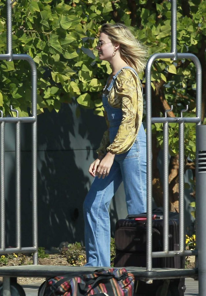 Margot Robbie in a Yellow Floral Blouse