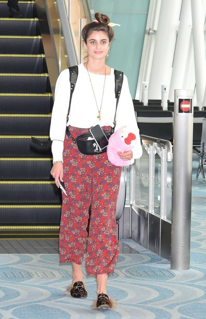 Taylor Hill in a Red Floral Pants