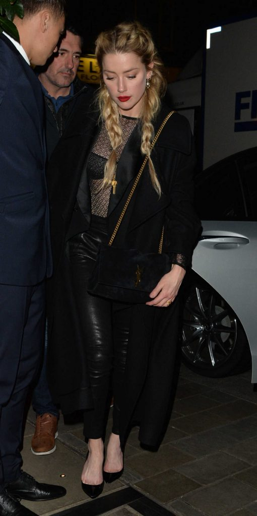 Amber Heard in a Black Coat