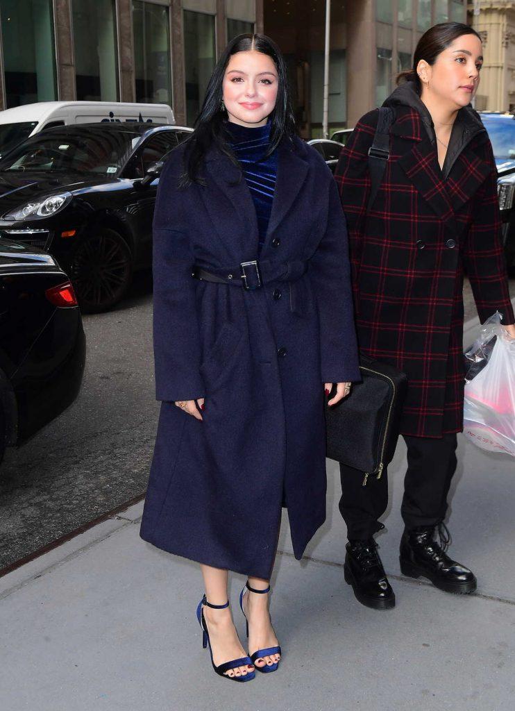 Ariel Winter in a Dark Blue Coat