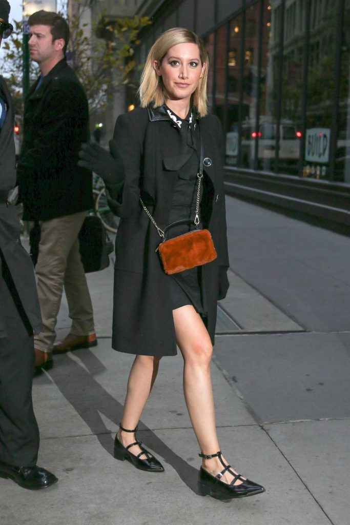 Ashley Tisdale in a Black Coat