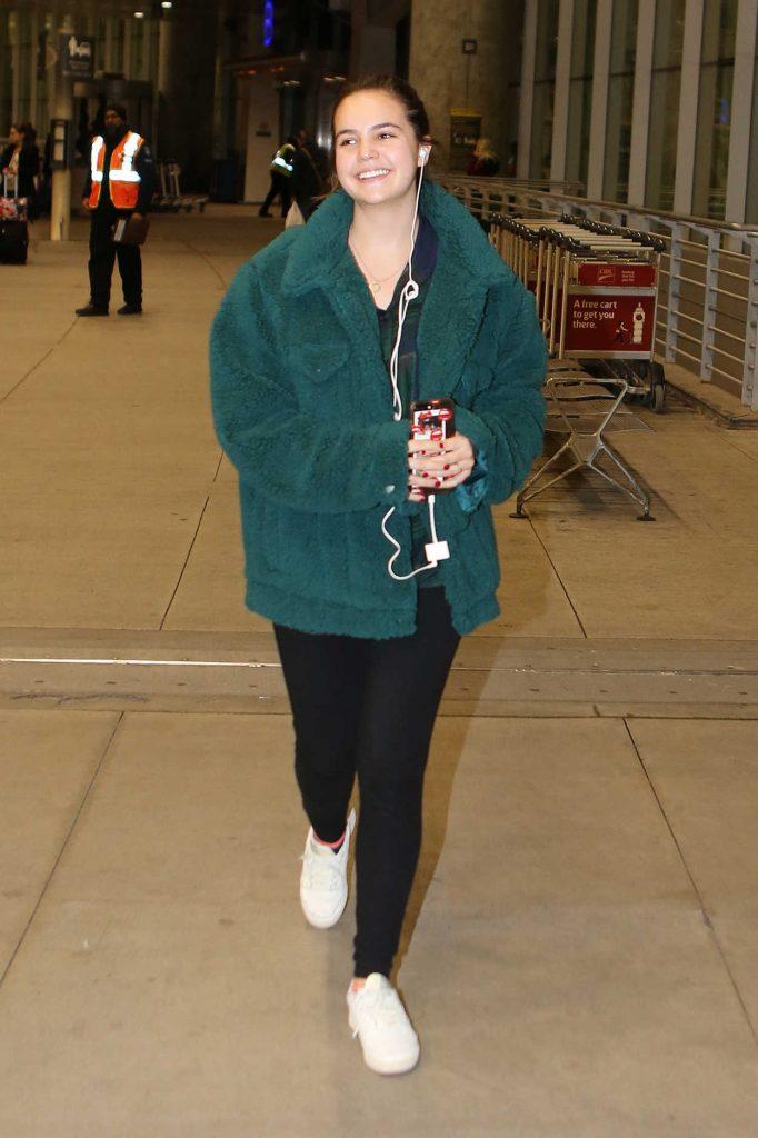 Bailee Madison in a Green Jacket