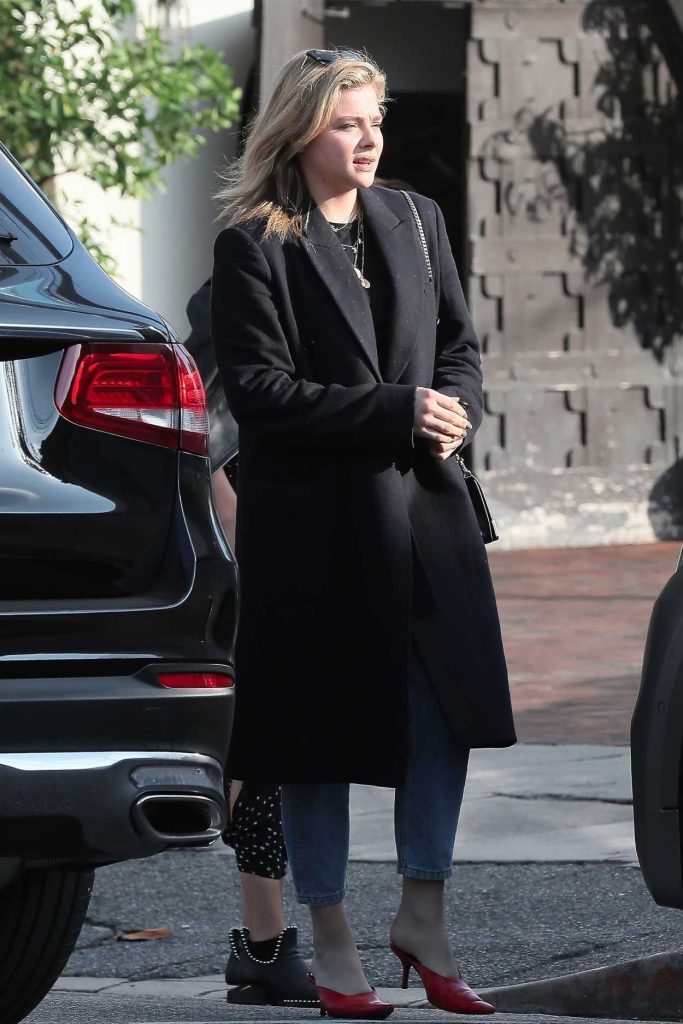 Chloe Moretz in a Black Coat
