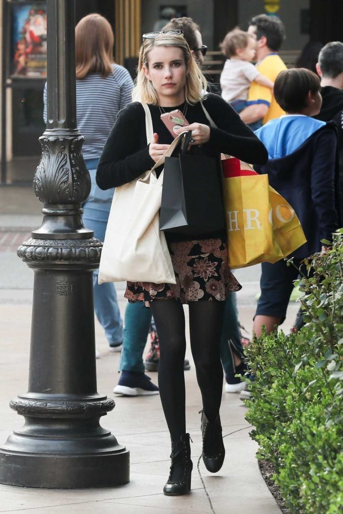 Emma Roberts in a Black Sweater