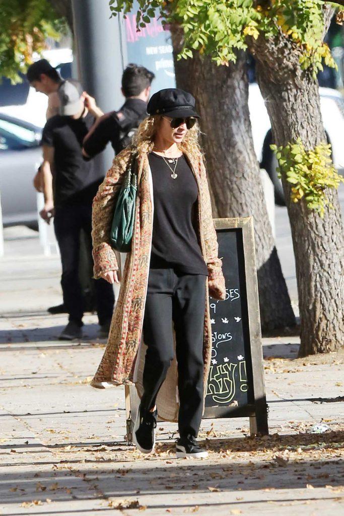 Nicole Richie in a Black Cap