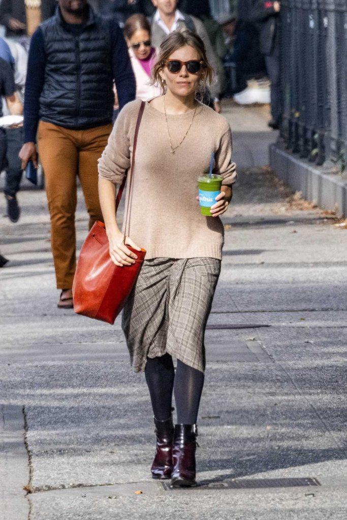 Sienna Miller in a Beige Sweater