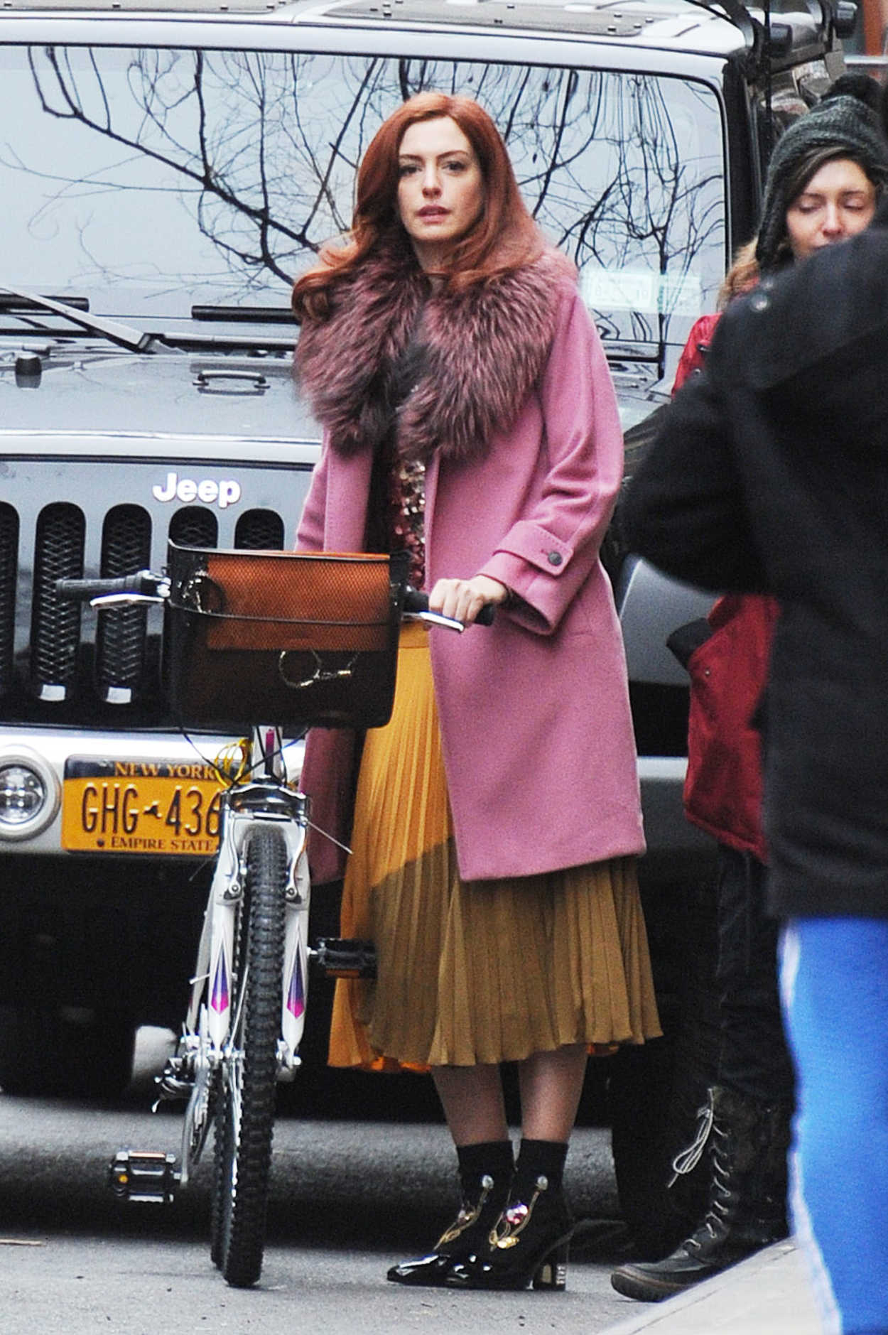 Anne Hathaway Rides a Bicycle on the Set of Modern Love in ...