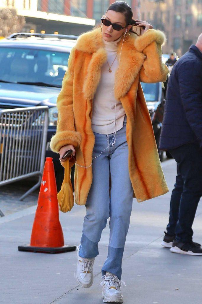 Bella Hadid in an Orange Fur Coat