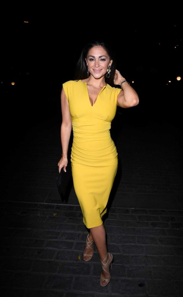 Casey Batchelor in a Yellow Dress