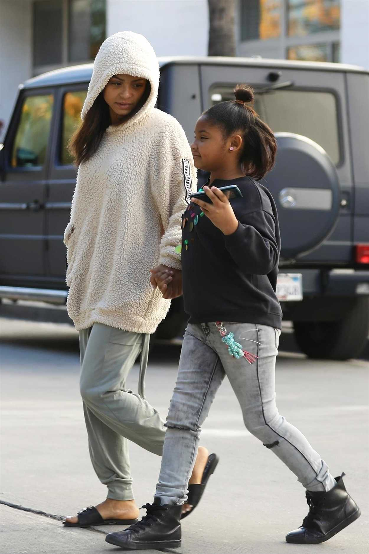 Christina Milian in a Beige Hoody Goes Christmas Shopping ...