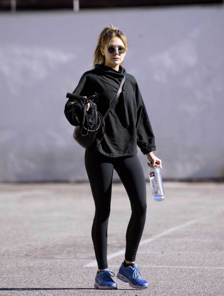 Elizabeth Olsen in a Black Leggings