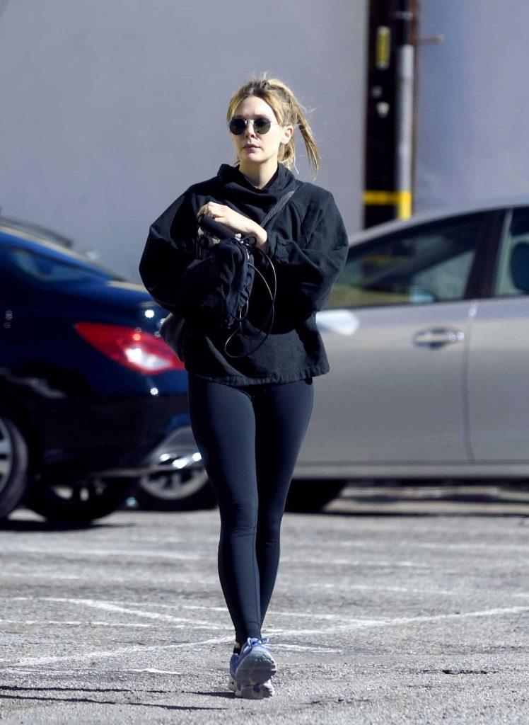 Elizabeth Olsen in a Black Leggings