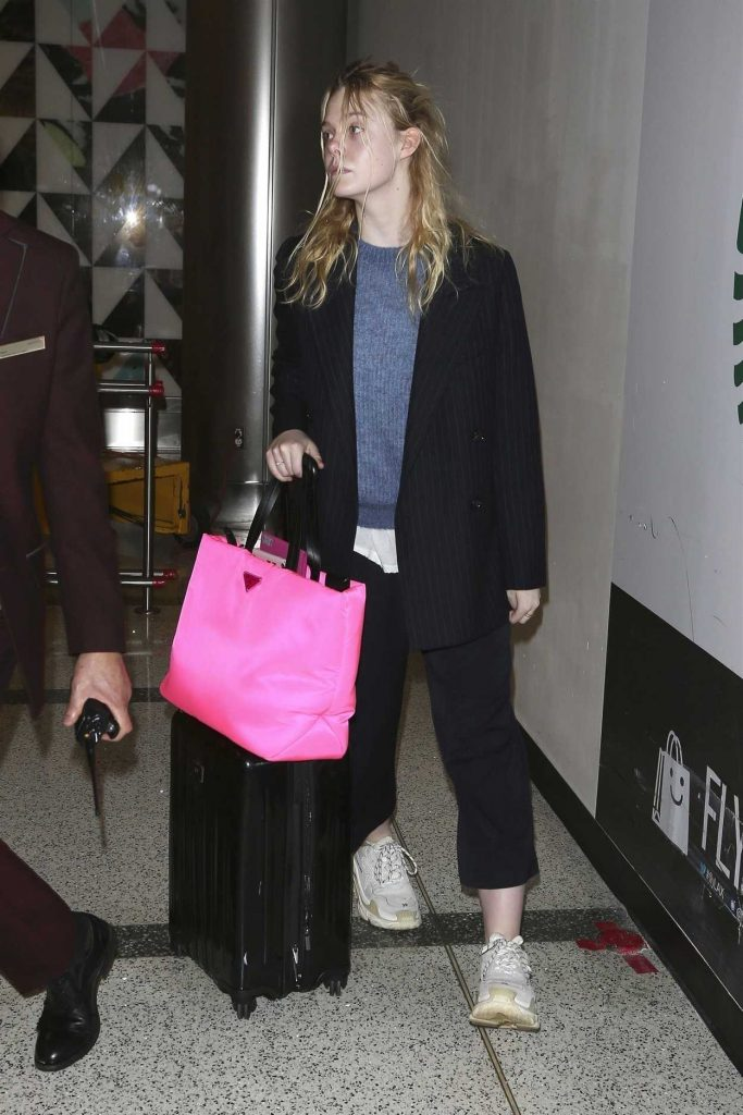 Elle Fanning in a Black Striped Blazer