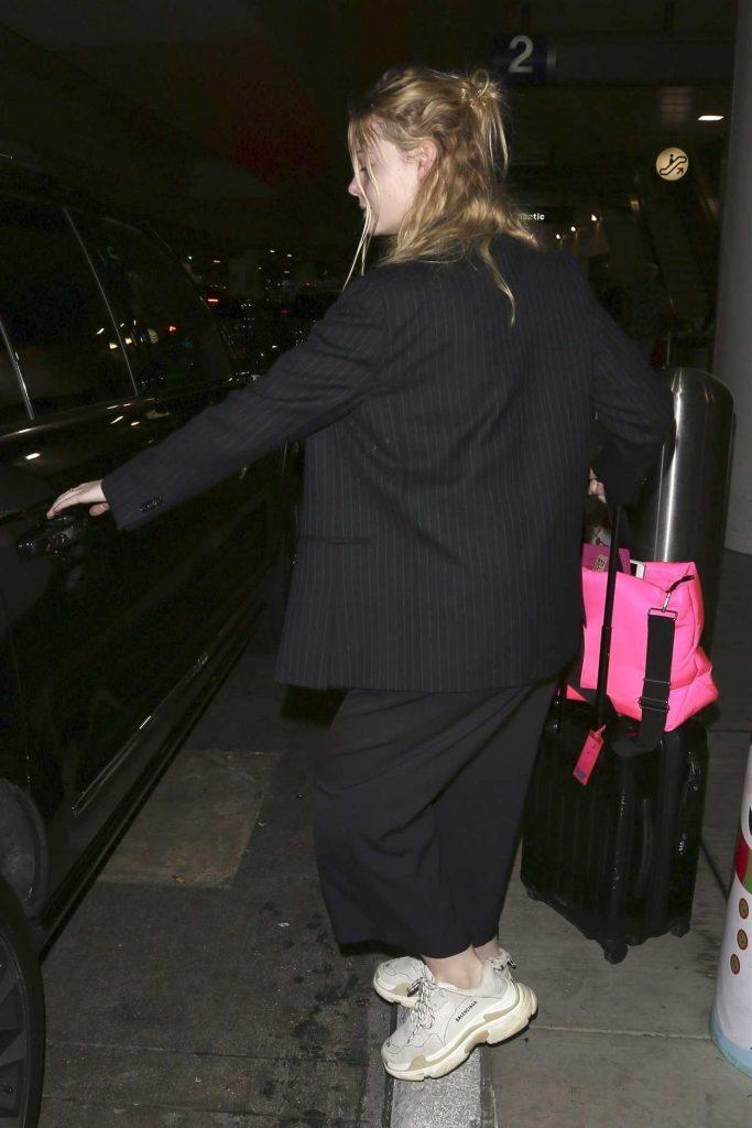 Elle Fanning in a Black Striped Blazer