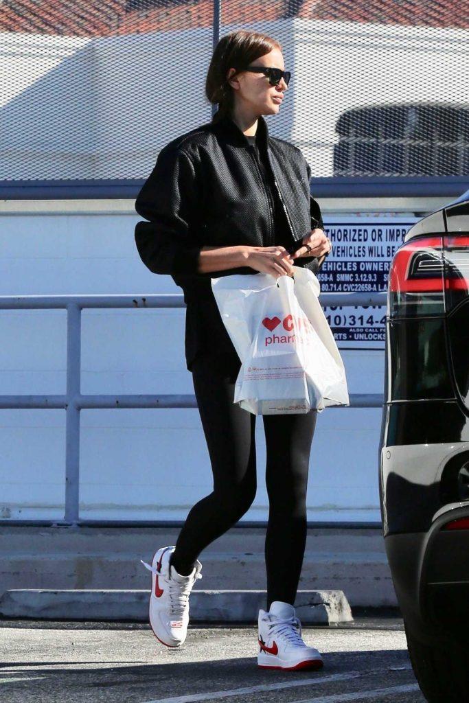 Irina Shayk in a White Nike Sneakers