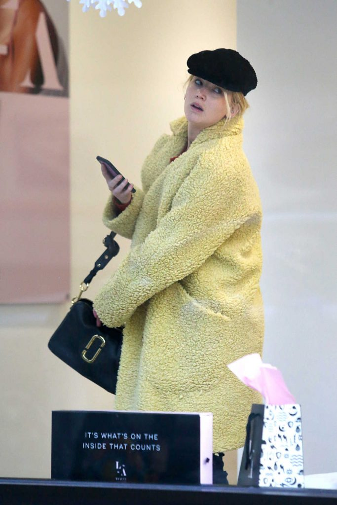 Jennifer Lawrence in a Yellow Fur Coat