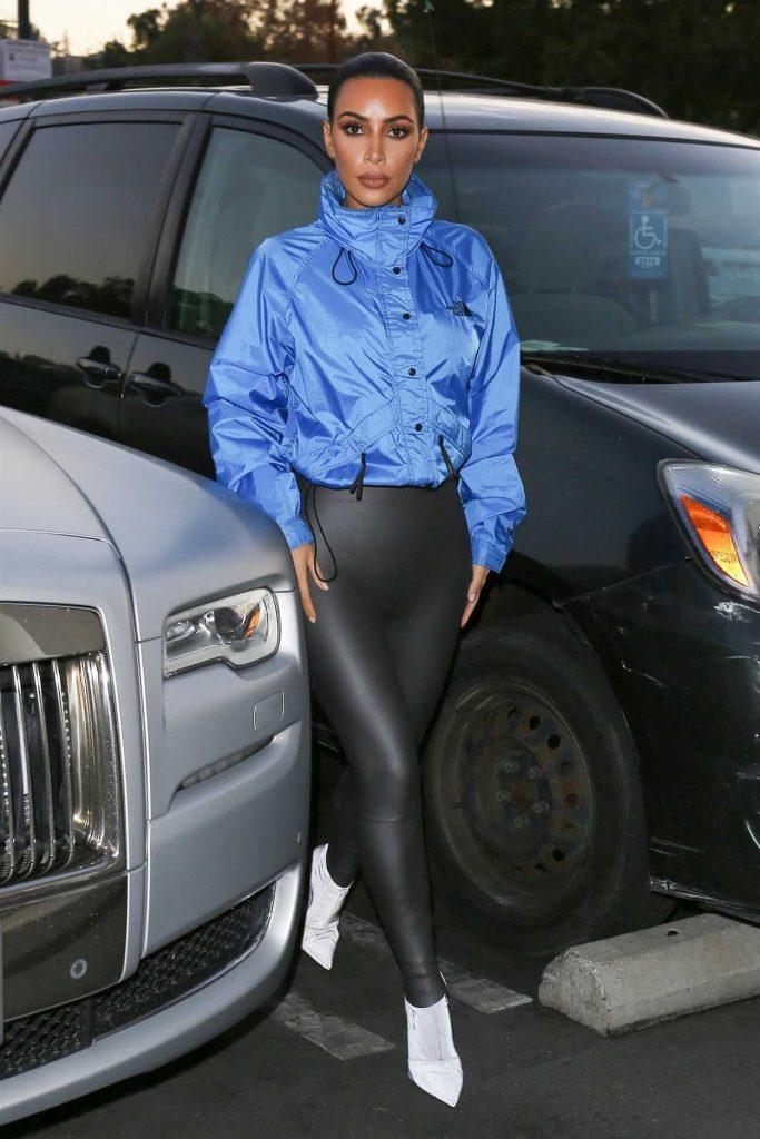 Kim Kardashian in a Light Blue Windbreaker