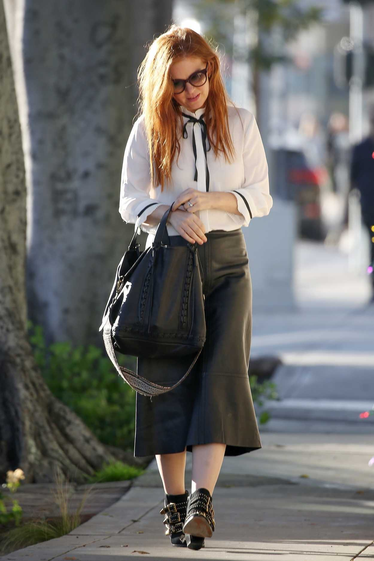 Isla Fisher In A Black Leather Skirt Was Seen Out In