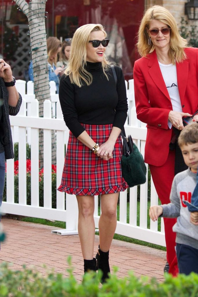 Reese Witherspoon in a Short Plaid Skirt