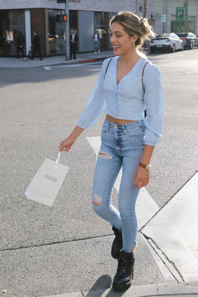 Sistine Stallone in a Blue Blouse