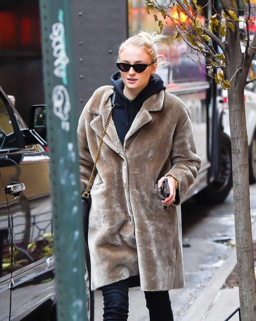 Sophie Turner in a Beige Fur Coat