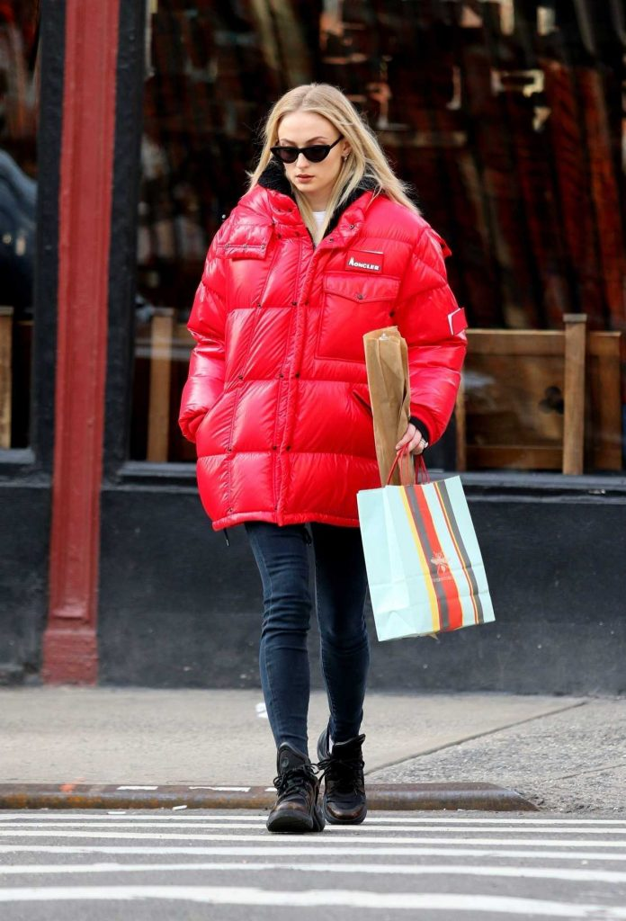 Sophie Turner in a Red Puffy Coat