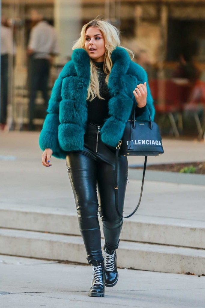 Tallia Storm in a Short Blue Fur Coat