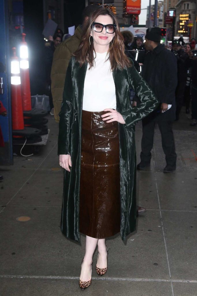 Anne Hathaway in a Green Trench Coat