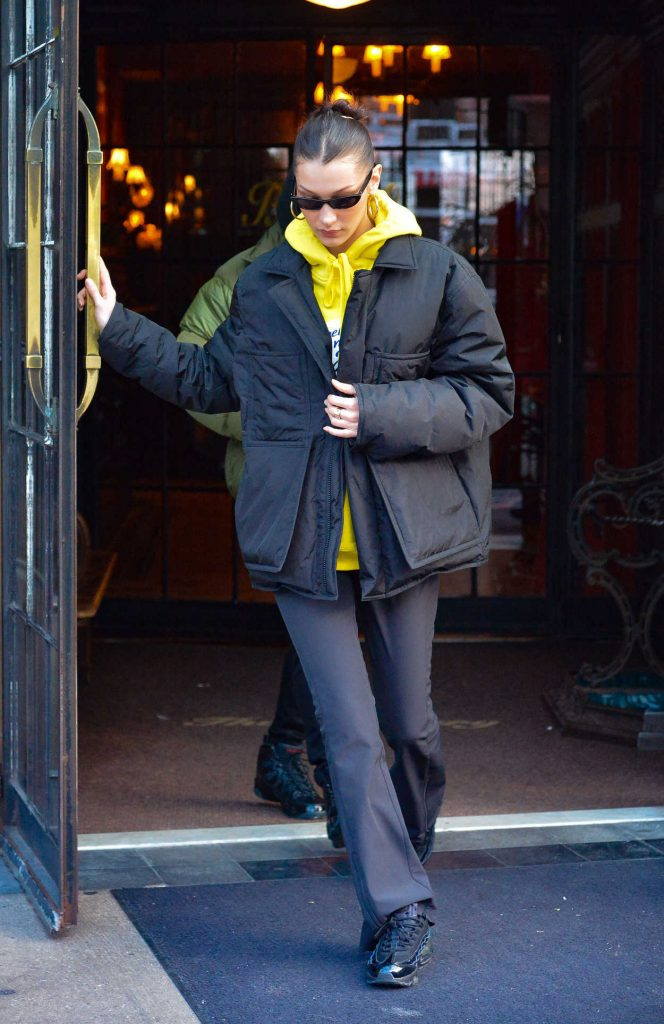 Bella Hadid in a Yellow Hoody