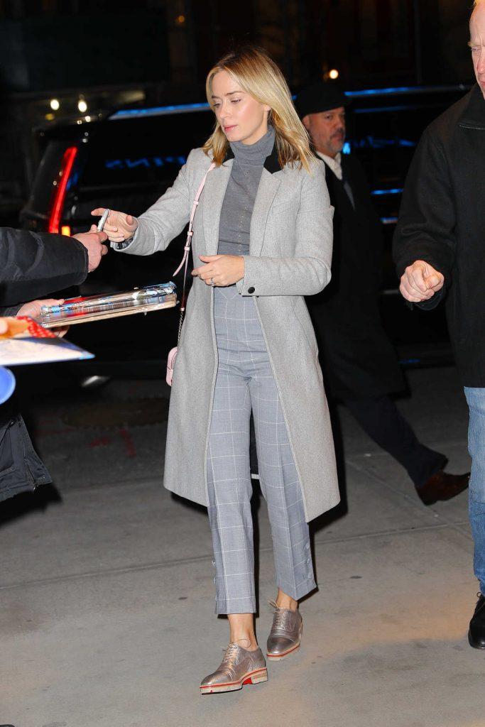 Emily Blunt in a Gray Coat