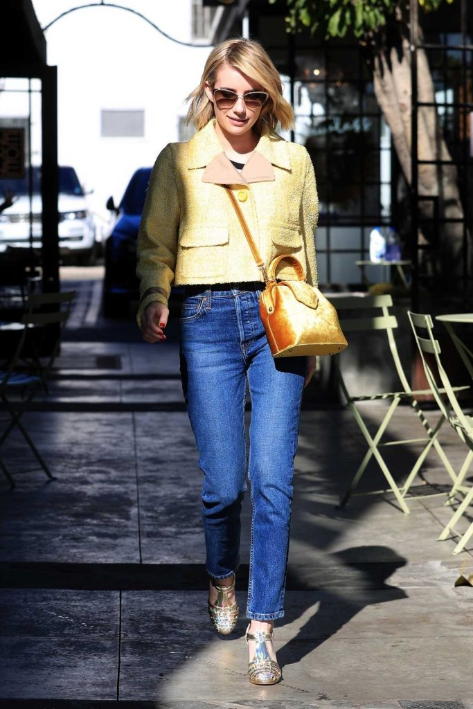 Emma Roberts in a Yellow Jacket
