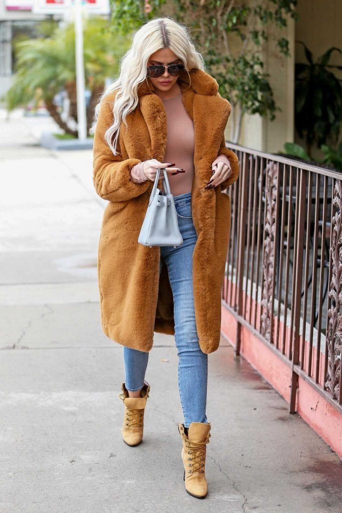 Khloe Kardashian in an Orange Fur Coat