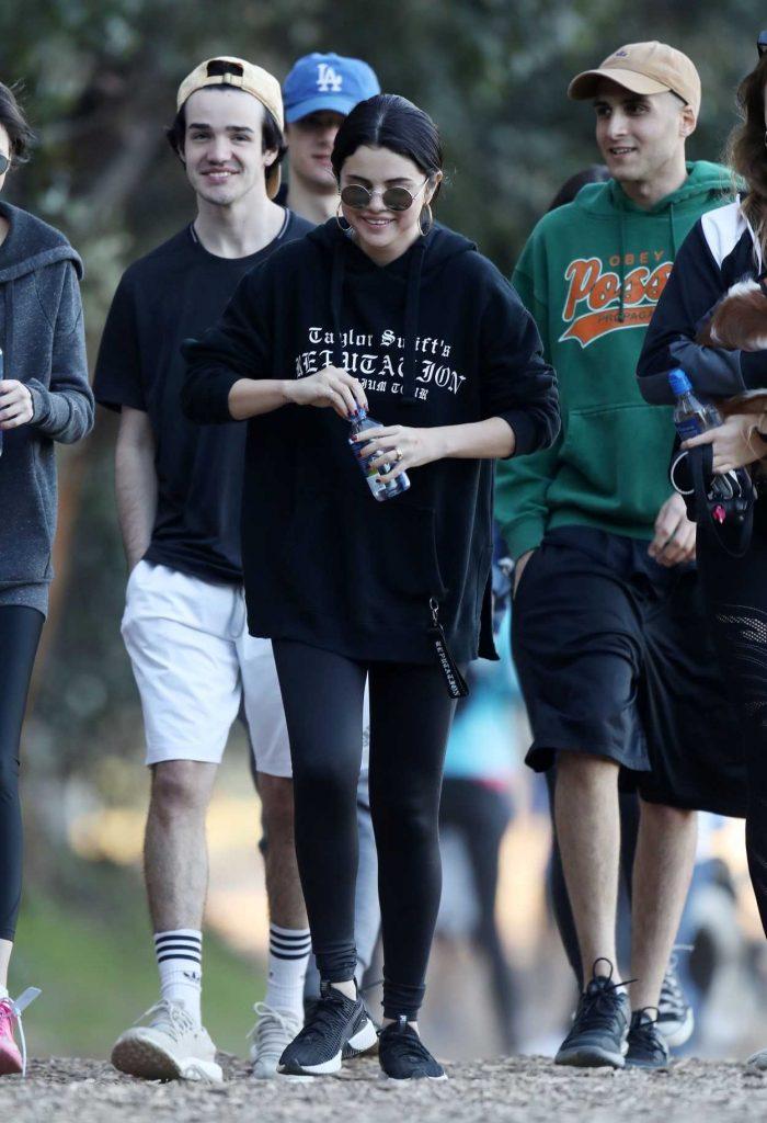 Selena Gomez in a Black Hoody