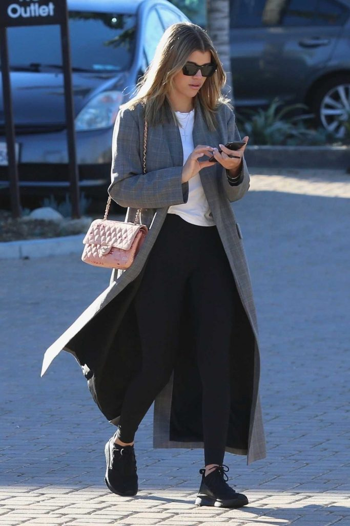 Sofia Richie in a Gray Trench Coat