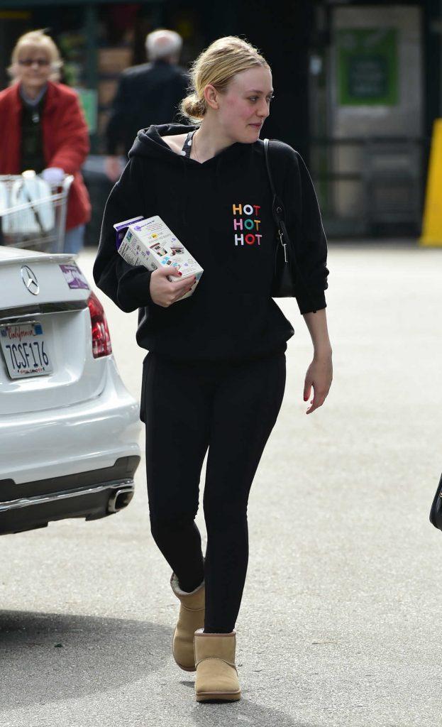 Dakota Fanning in a Black Hoody