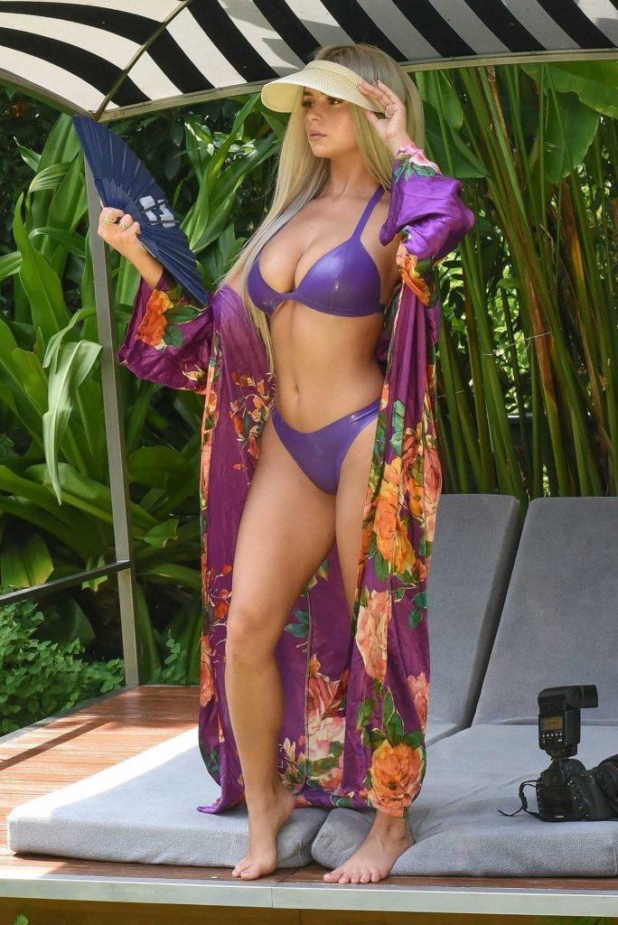 Demi Rose in a Purple Latex Bikini