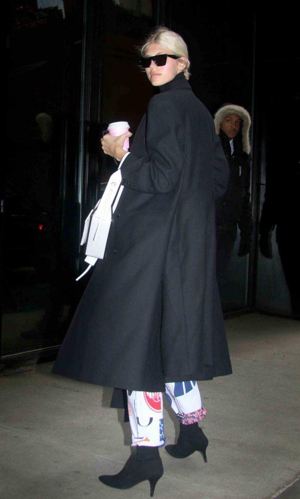 Devon Windsor in a Black Coat