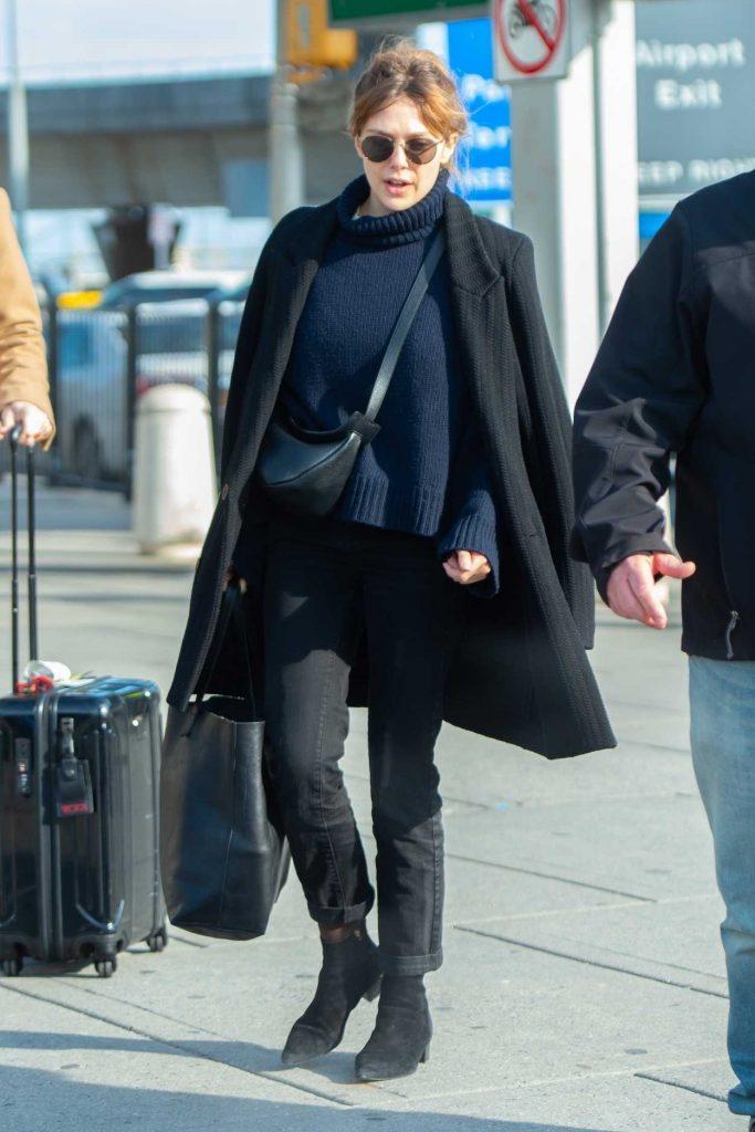Elizabeth Olsen in a Black Coat
