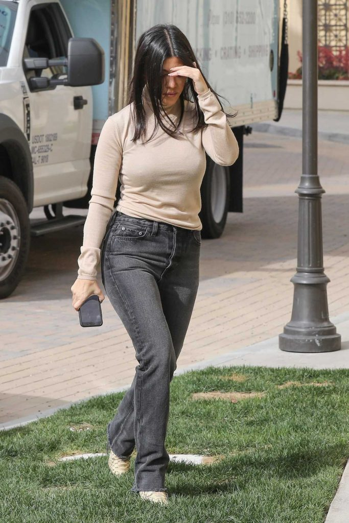 Kourtney Kardashian in a Beige Turtleneck
