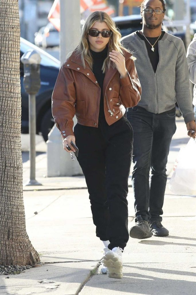 Sofia Richie in a Brown Leather Jacket