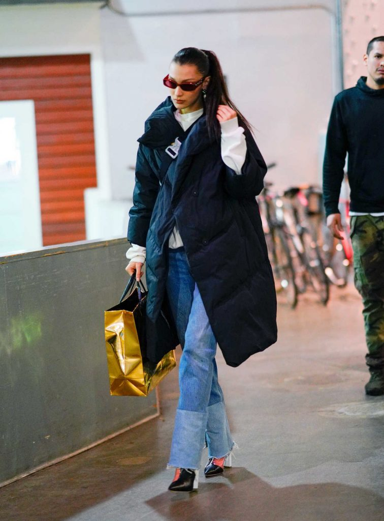 Bella Hadid in a Dark Blue Puffer Coat