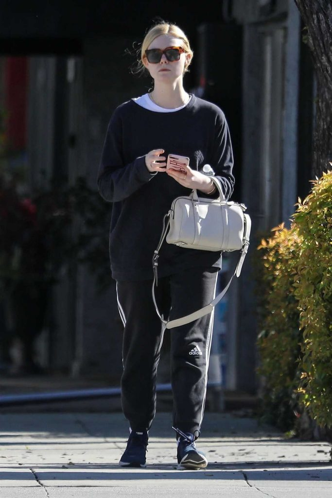 Elle Fanning in a Black Adidas Track Pants
